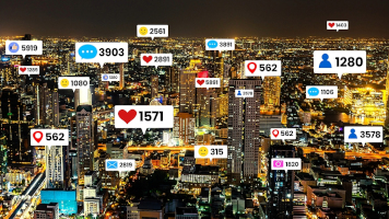 Social media icons fly over city downtown showing people engagement connection through social network application platform . Concept for online community and social media marketing strategy