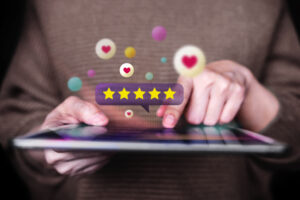 Customer Experiences Concept. Closeup of Woman Using Digital Tablet to Giving Feedback via the Internet. Positive Review. Client Satisfaction Surveys. Front View