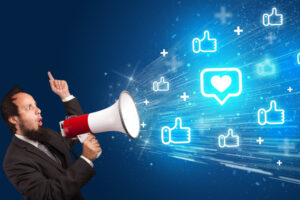 Young person yellin in loudspeaker with speech bubble with a heart icon, social networking concept